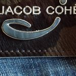 Display of Jacob Cohen brown jean logo