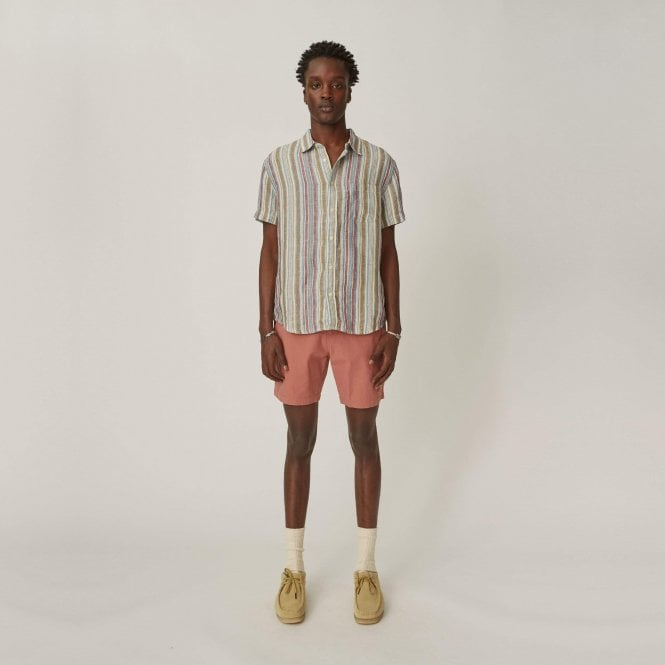 A photo of a man modelling a colorful Corridor Striped Short Sleeve Shirt and pink shorts.